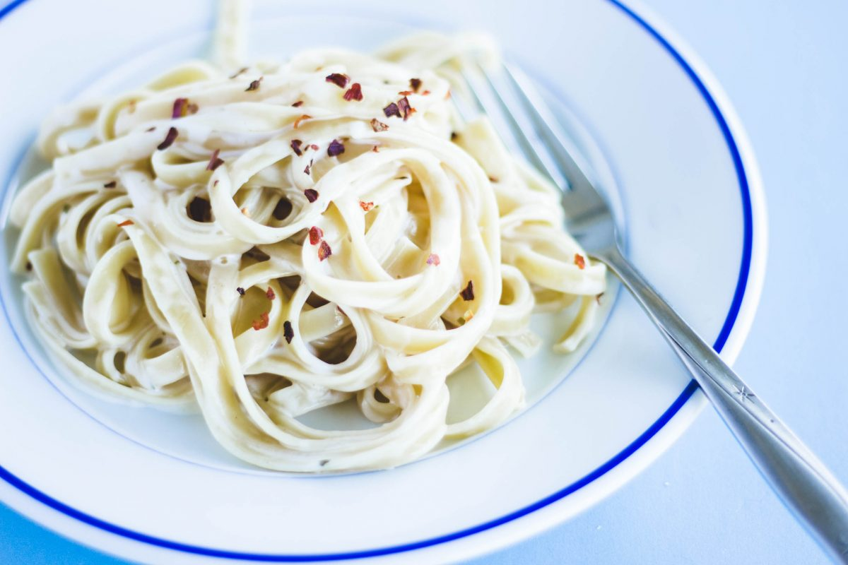 Fettuccini Alfredo toped with pepper flakes