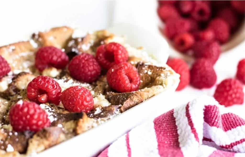 maple french toast topped with raspberries