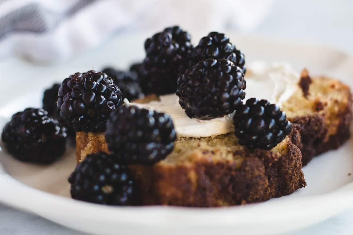 breakfast bread topped with cream cheese and blackberries