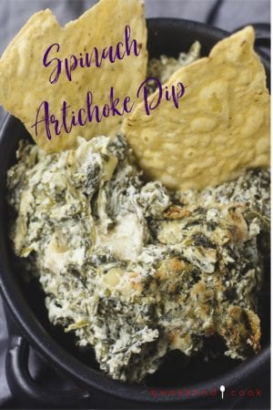 spinach artichoke dip in a bowl with tortilla chips