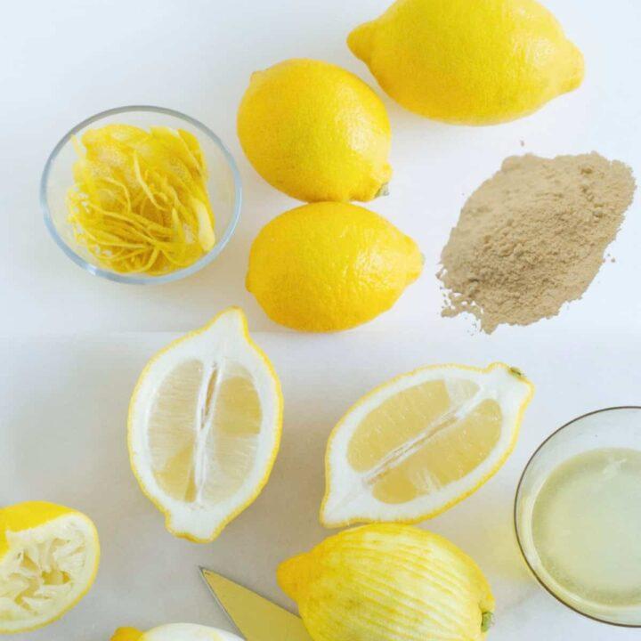 mound of lemon juice powder next to cut lemons