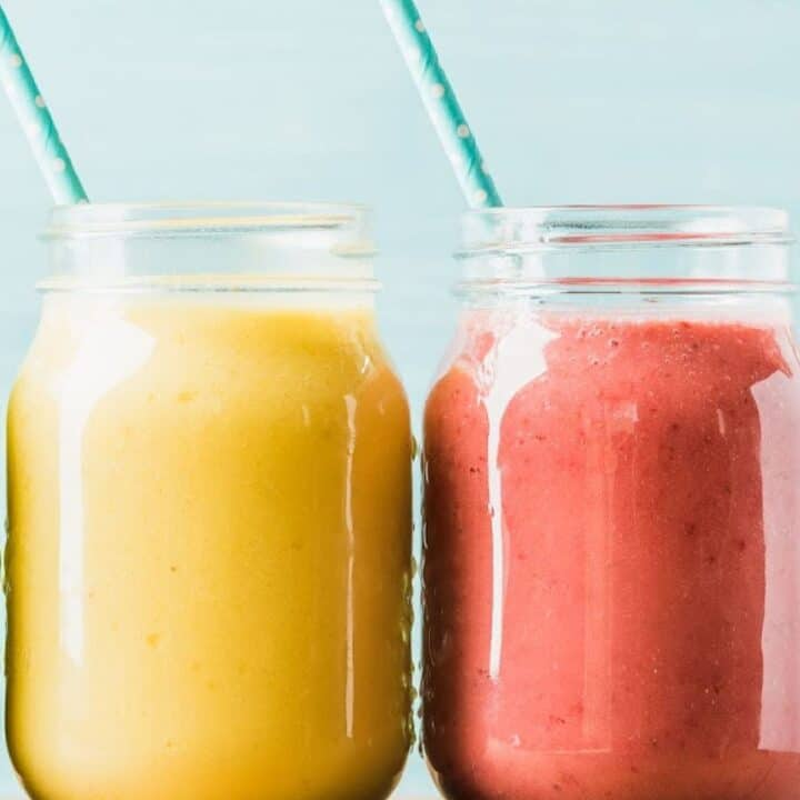 fruit smoothies in mason jars with straw